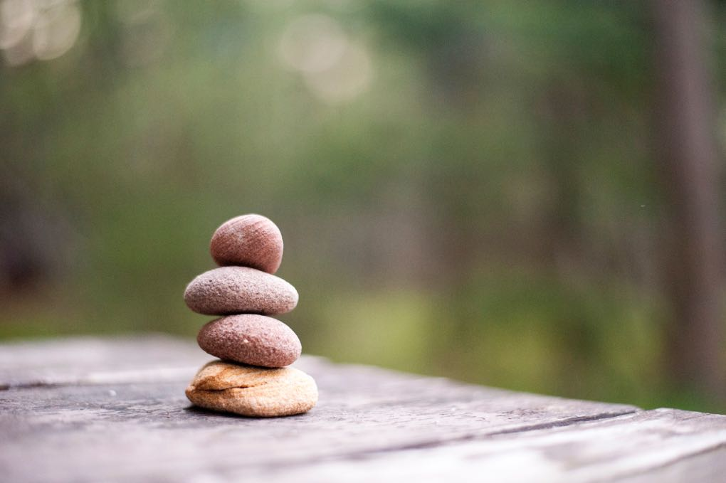 Photo of stones balanced on each other as a symbol of meditation