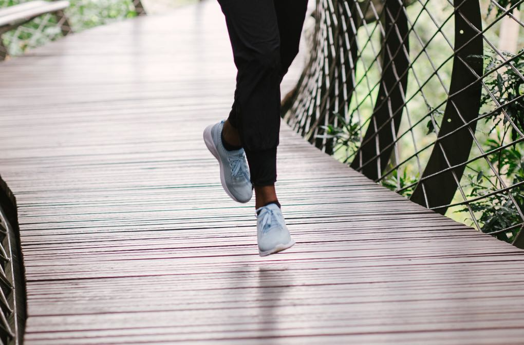 1020 - photo of legs running on bridge