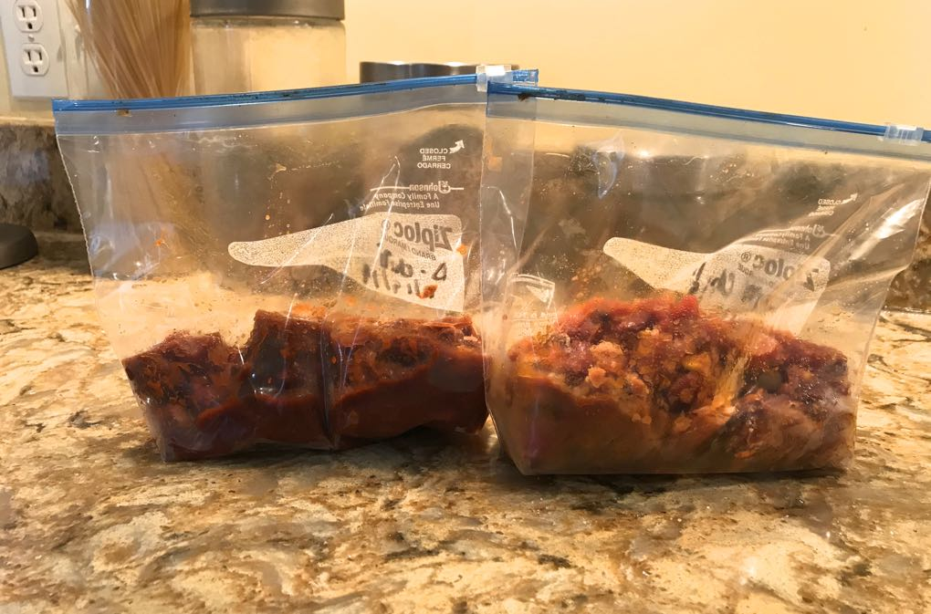 Photo of baggies of frozen chili sitting on a counter as an example of freezing leftovers and other food