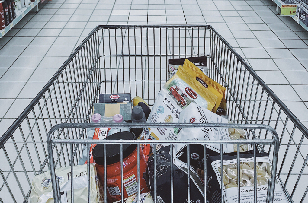 Photo of grocery cart full of groceries as example of meal planning
