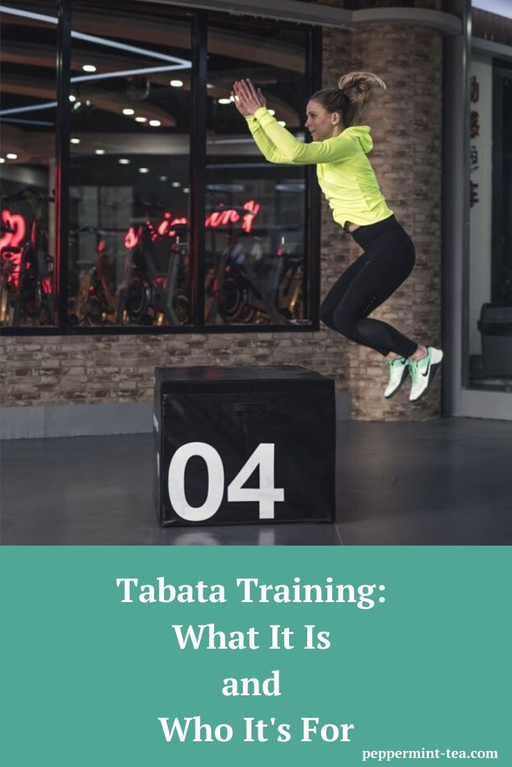Photo of woman doing box jumps, which could be a type of Tabata training