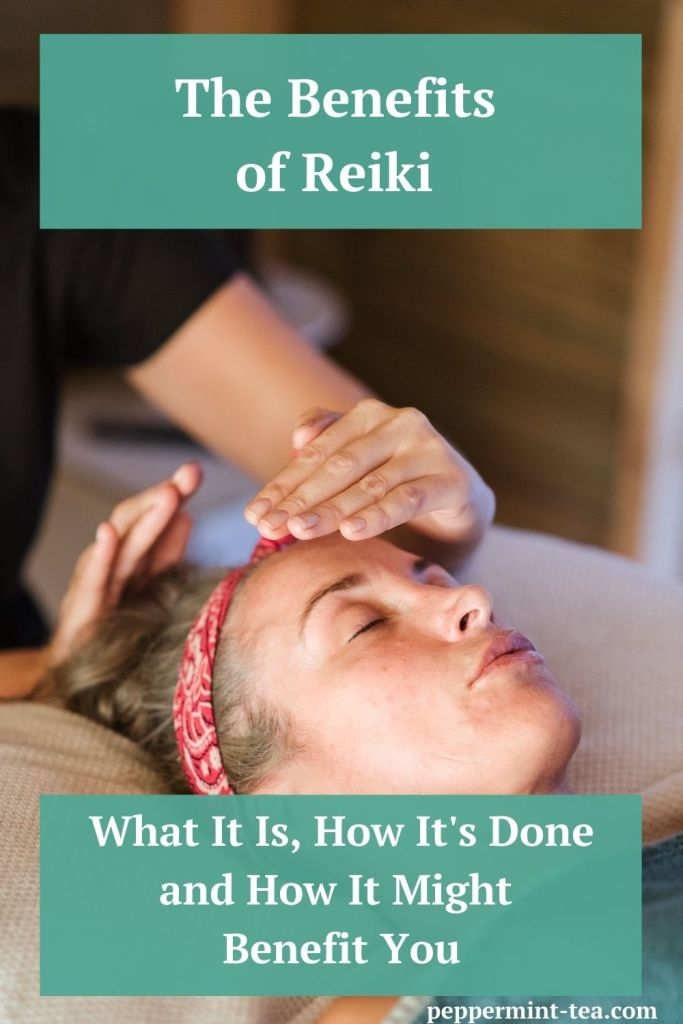Photo of woman lying down with a woman's hands hovering about her head as an example of the benefits of Reiki